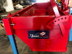Chip Spreader, AmeriSpreader by PavementGroup shown with adjustable gate and mounting legs