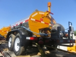 Asphalt Distributor Trailer and Trucks, STRATOS brand by Pavement Technologies Int'l Corp. Shown with 8' spraybar and 50' hose